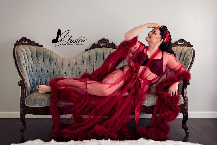 woman in red robe on blue victorian couch