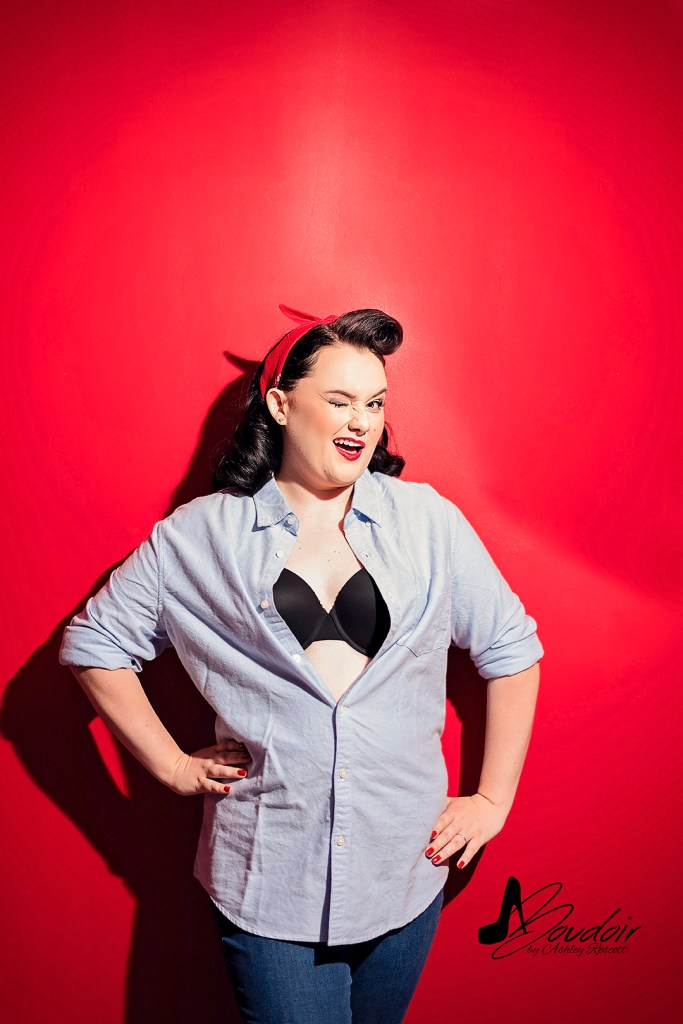 Pin up on red wall, man's shirt