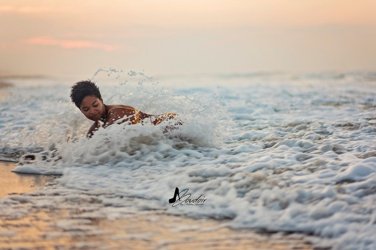 woman in waves on beach