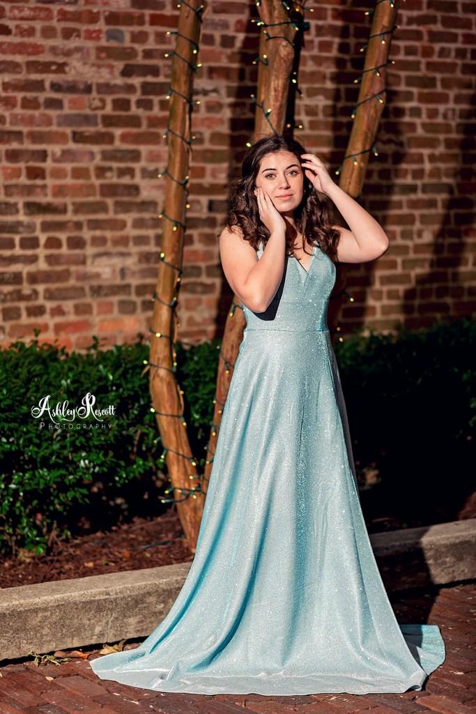 brunette teen girl in blue dress