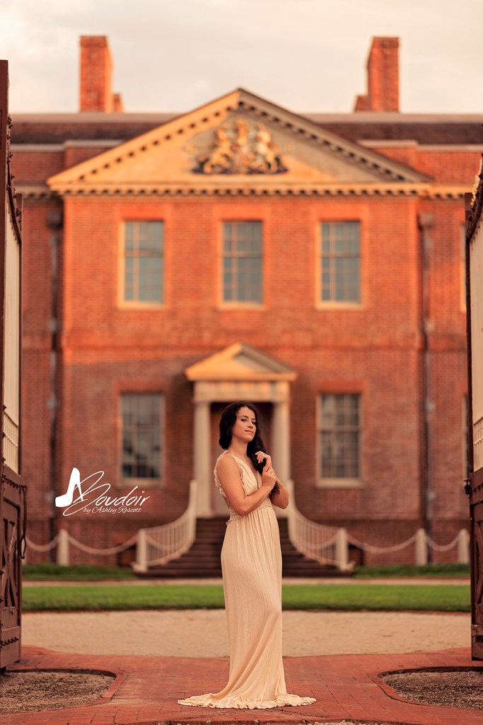 woman in dress in front of palace