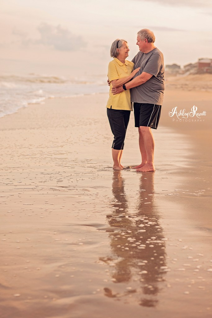 couple looking at each other on beach