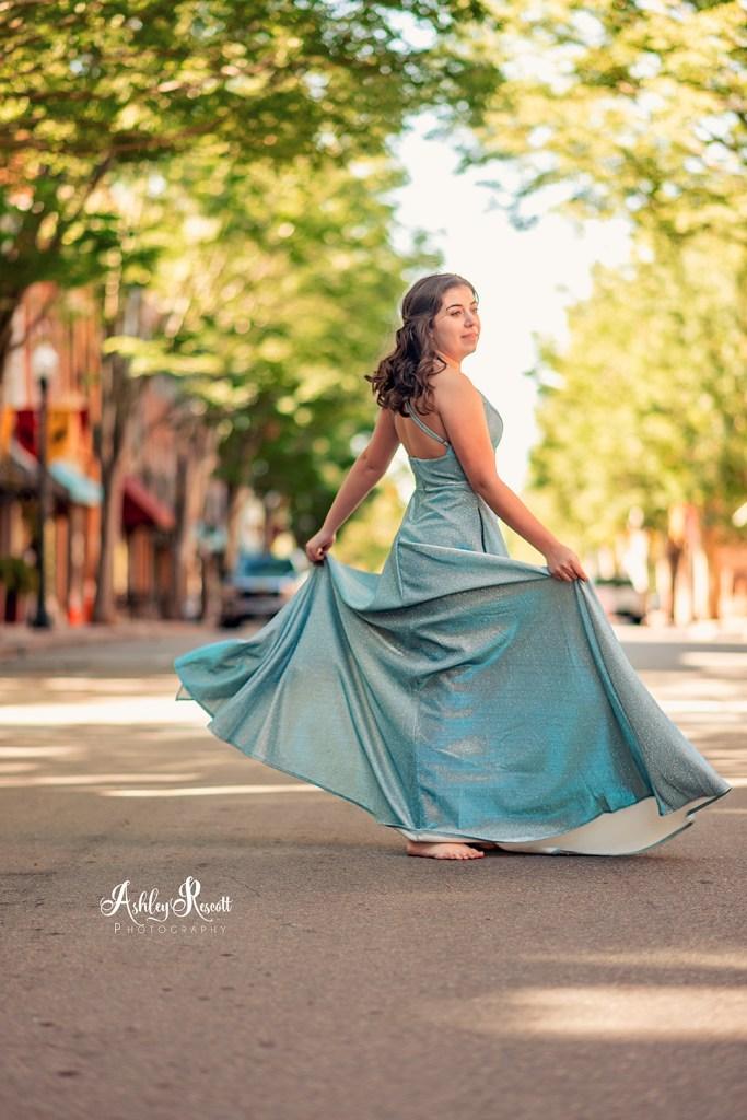 senior girl twirling in prom dress