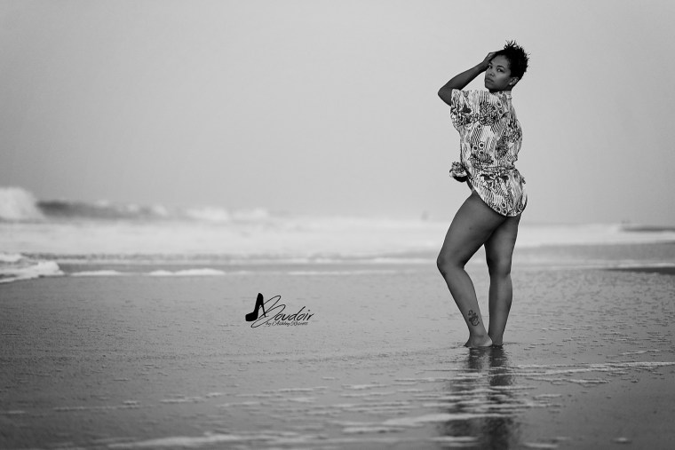 black and white image of woman on beach