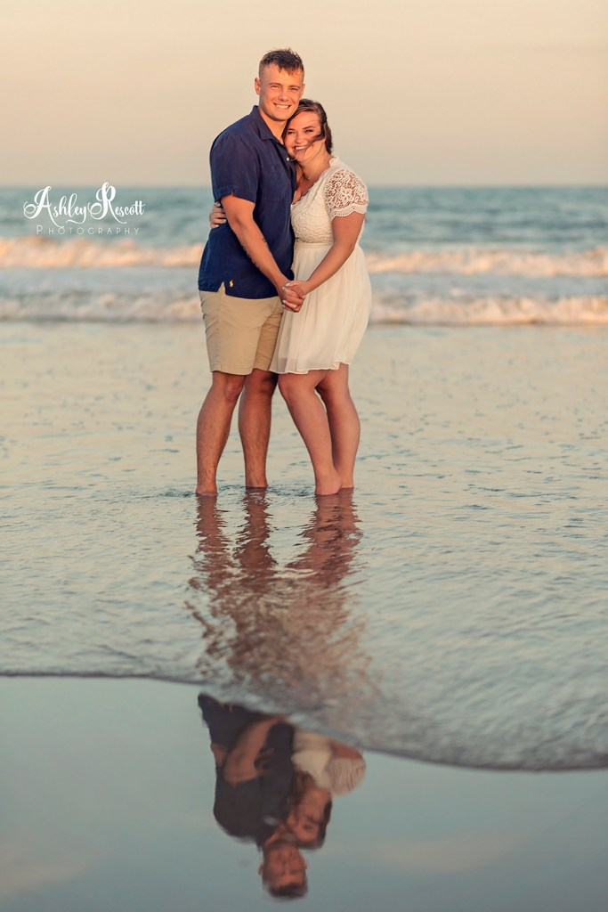 couple on beach at sunset