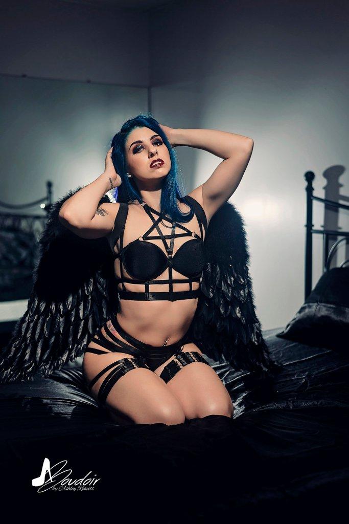 dark angel kneeling on bed