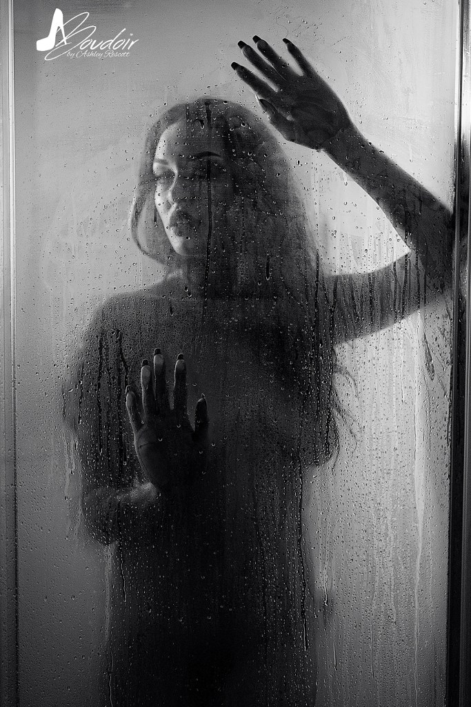 woman with hands on glass shower