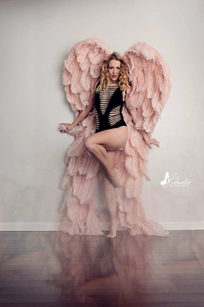 woman standing in angle wings