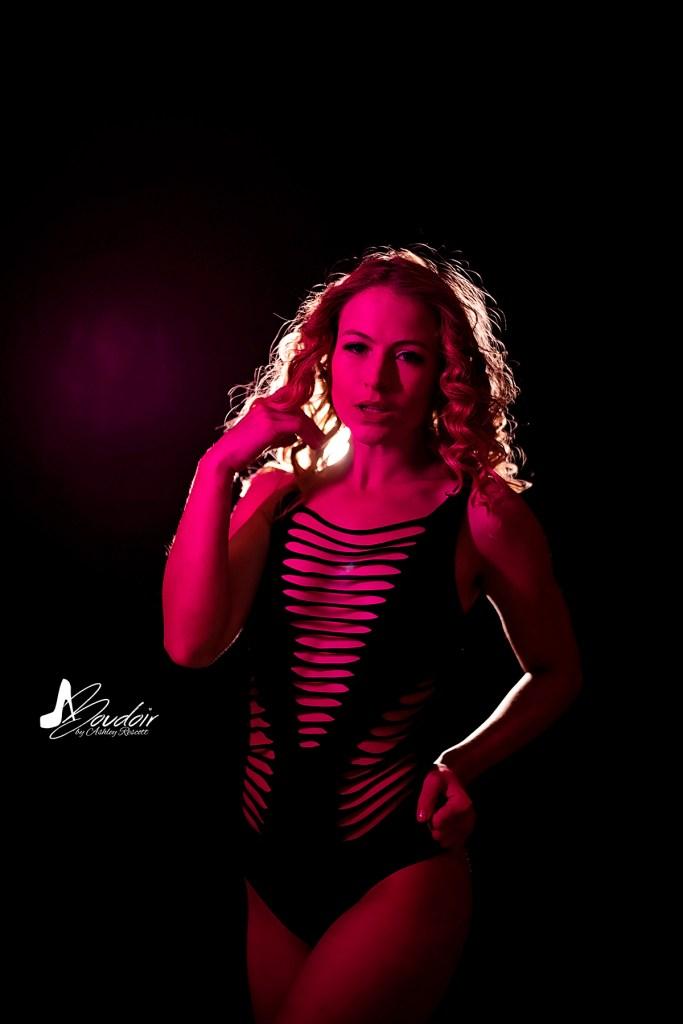 model backlit with pink fill light, neon boudoir