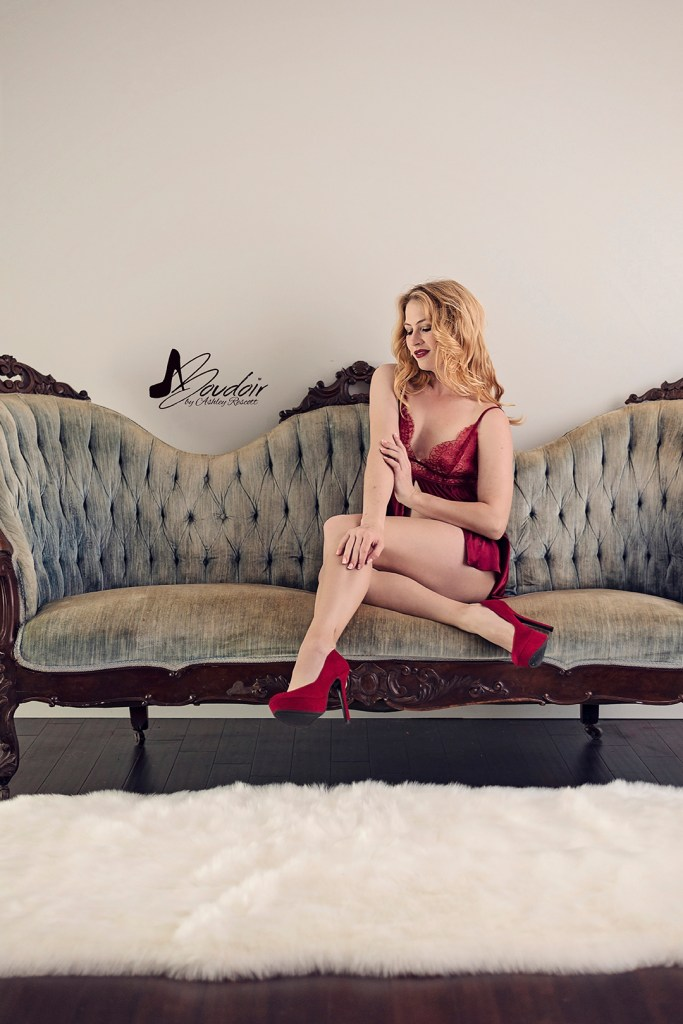 woman in red lingerie sitting on blue couch