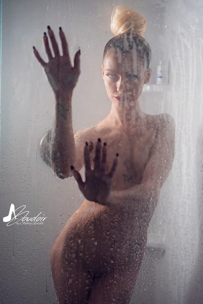 dramatic implied nude shower boudoir image of model