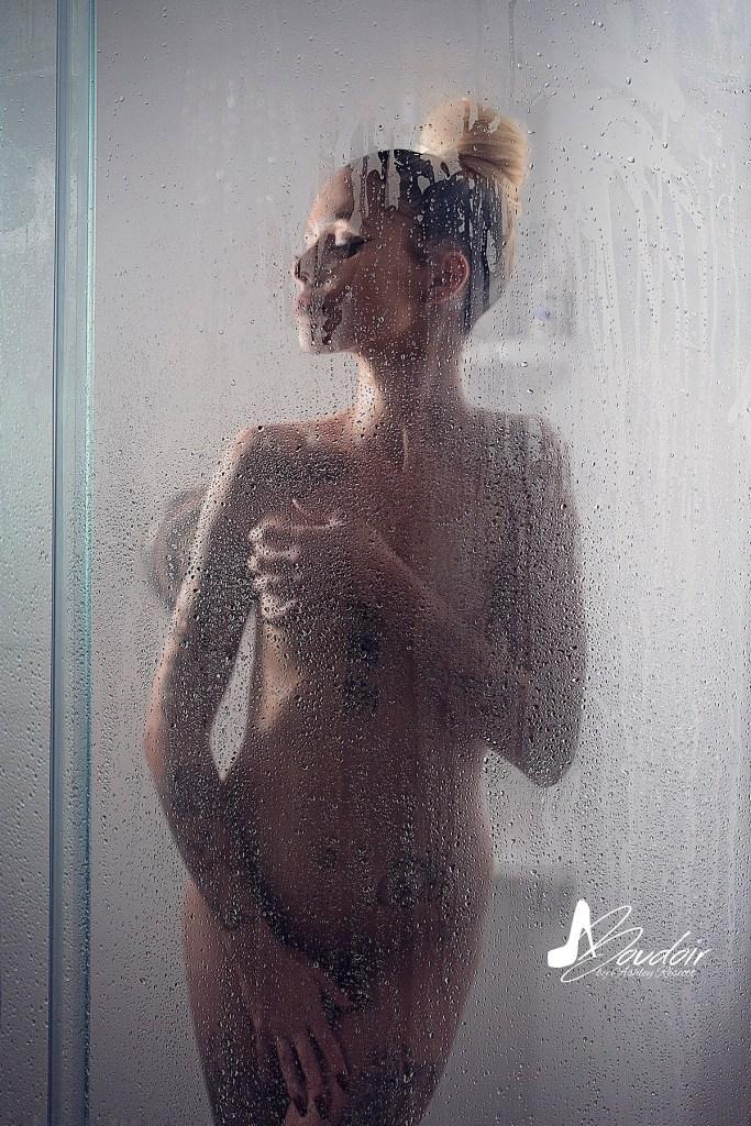 implied nude blonde model in shower