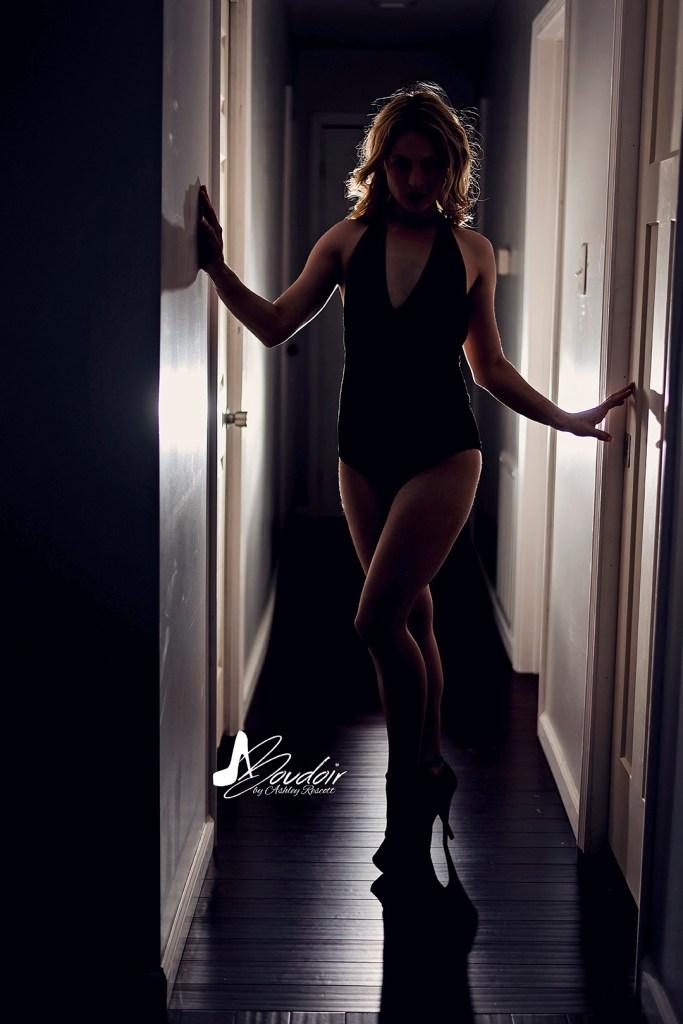 backlit woman in hallway