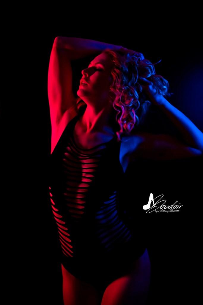 neon boudoir model in split light
