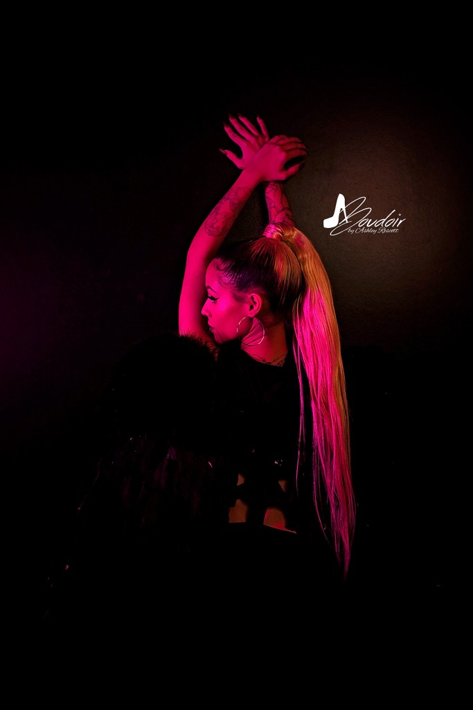 woman in pink neon lighting from behind, dramatic boudoir