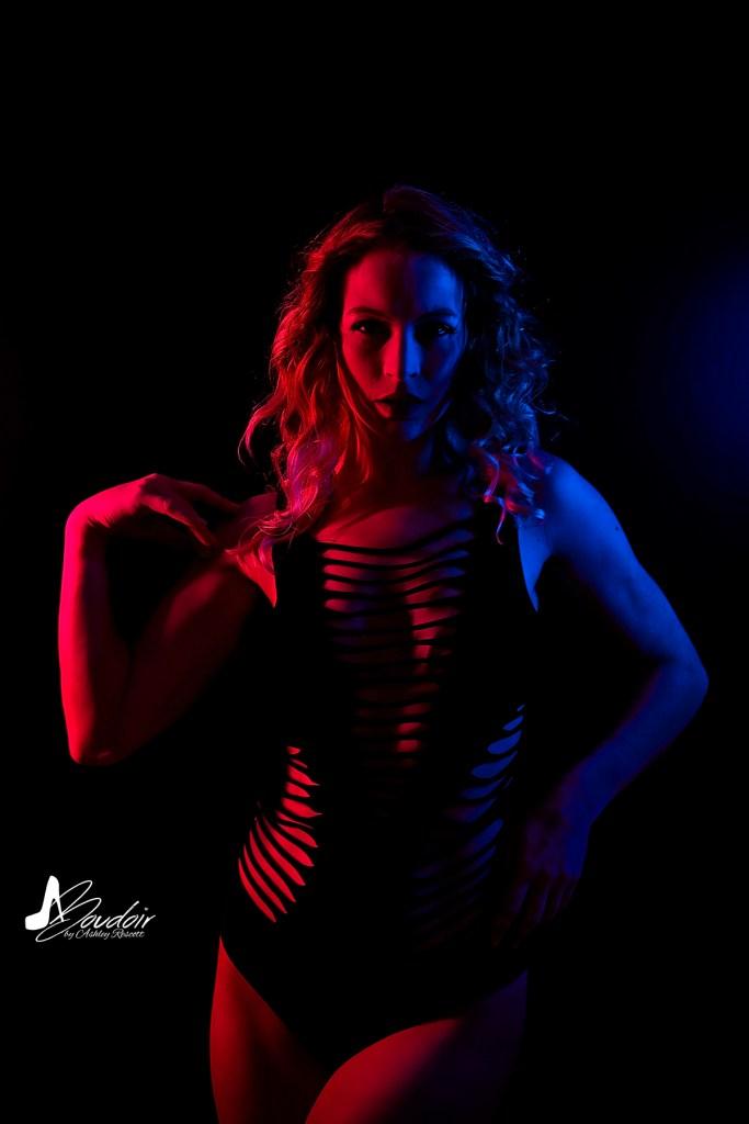 Model in split neon light