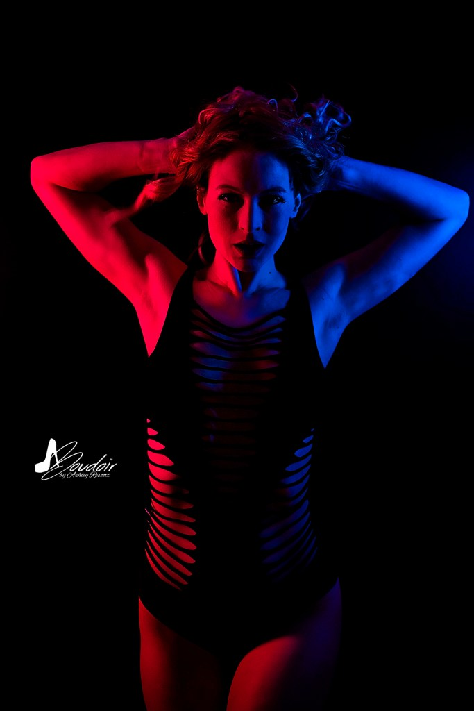 neon boudoir, split lighting, model playing with hair