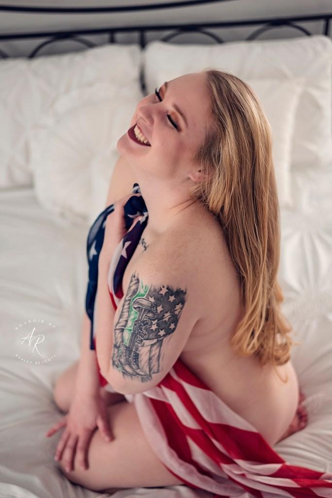 woman laughing wearing flag scarf