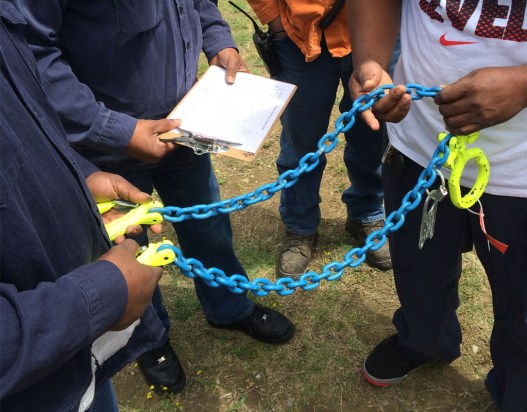 Inspecting Alloy Chain Sling during training