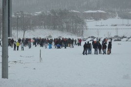 Students gathered in the band field to play in the snow