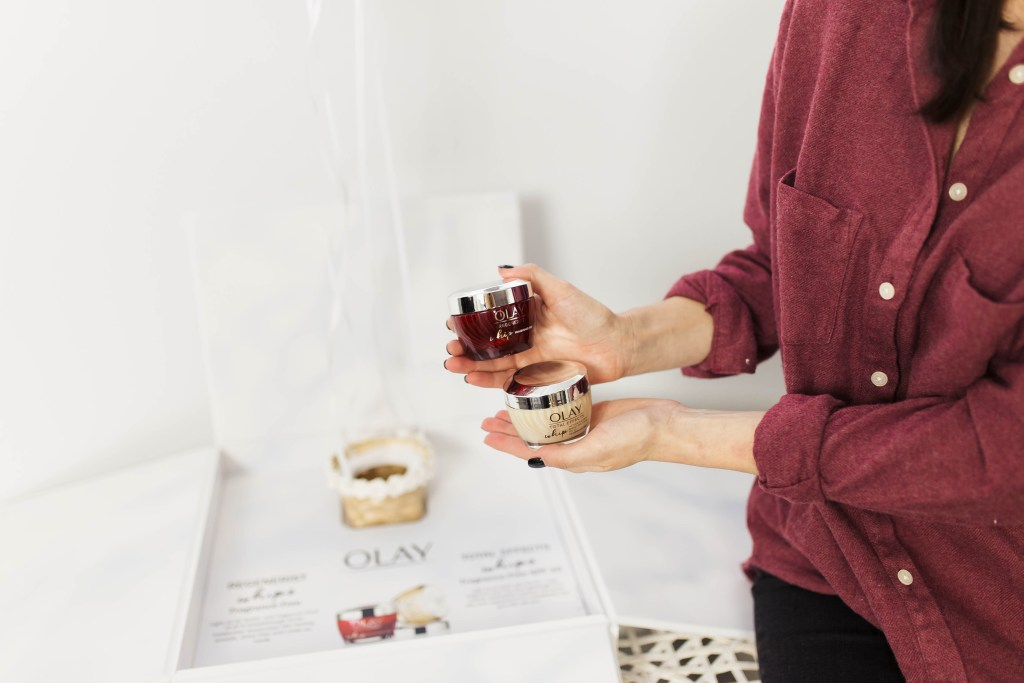 Top 3 reasons to use the new Olay Regenerist Whip fragrance Free moisturizer featured by top Los Angeles beauty blogger, Ashley Hodgesbrunette woman wearing a red button up shirt and holding the new Olay Regenerist Whip frangrance free moisturizer
