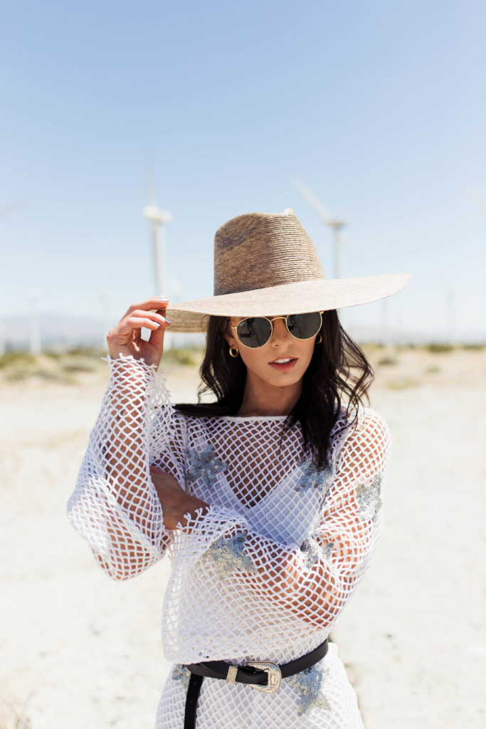 Revolve Festival Looks featured by top US fashion blogger Ashley Hodges; Image of a woman wearing white mesh dress.