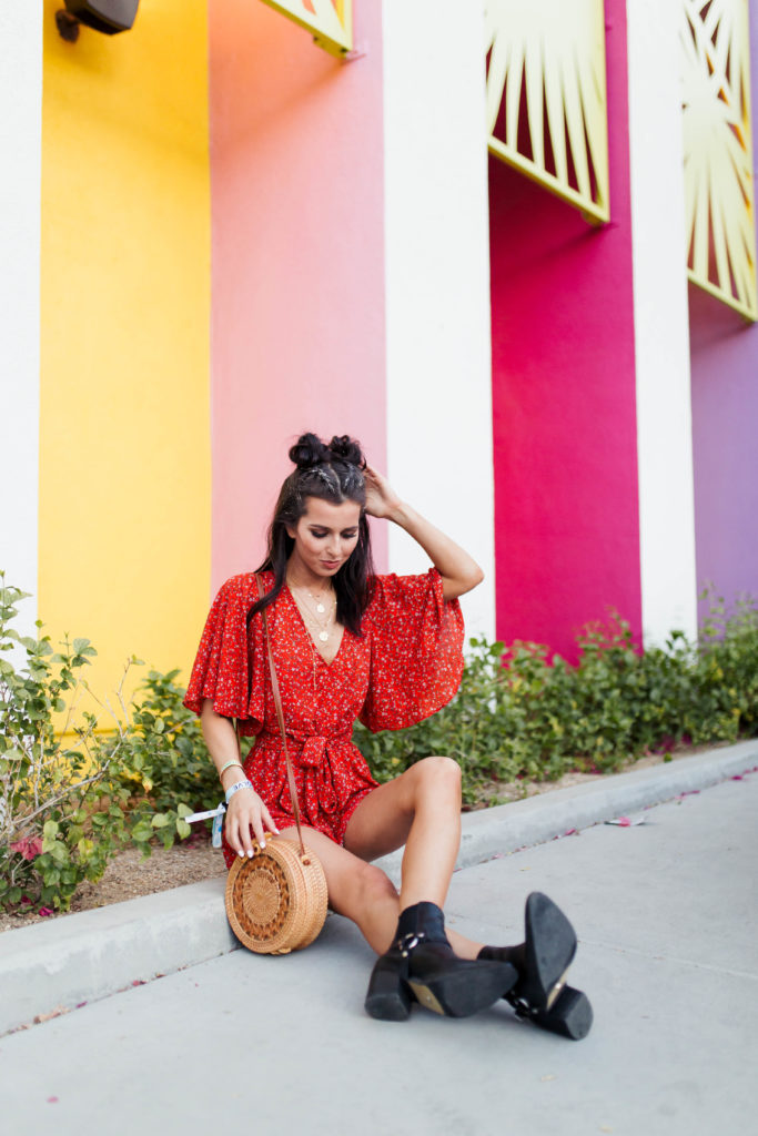 Revolve Festival Looks featured by top US fashion blogger Ashley Hodges; Image of a woman wearing red floral romper.