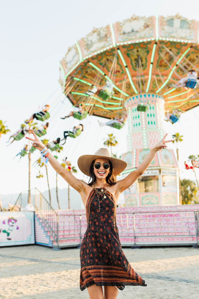 Revolve Festival Looks featured by top US fashion blogger Ashley Hodges; Image of a woman wearing dress at theme park.