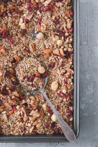 Overhead photo of a tray of lemon, ginger and cranberry granola