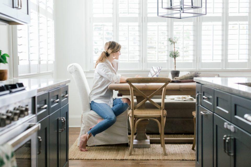 Ashlyn Carter sitting at desk - Ashlyn Writes