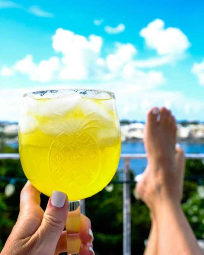 photo of feet up on a railing with a minosa