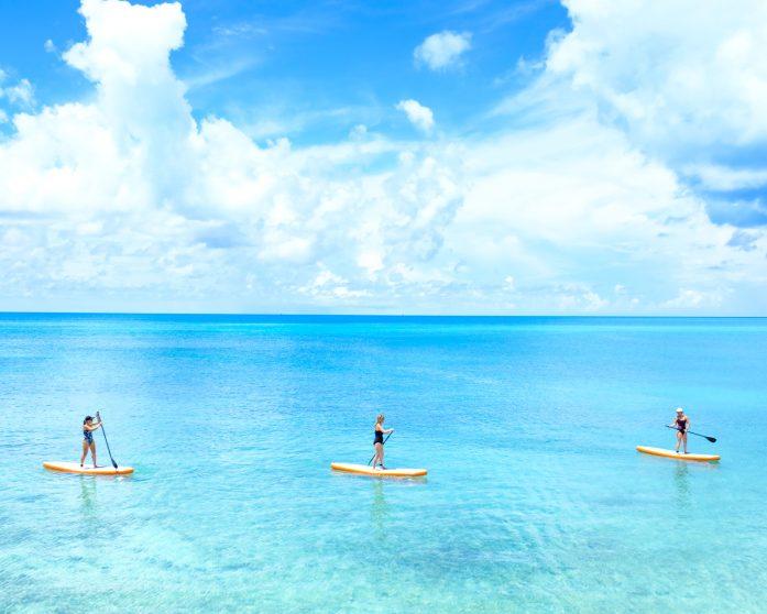 three girls paddle boarding in Bermuda