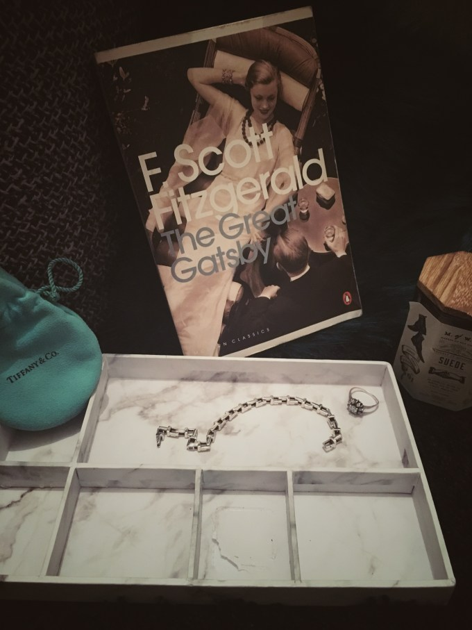 The Great Gatsby by F. Scott Fitzgerald with sterling silver T chain bracelet from Tiffany & Co.