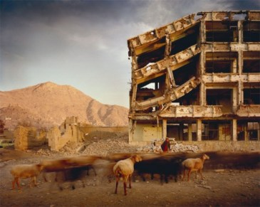 Simon Norfolk: Bullet-scarred apartment building and shops in the Karte Char district of Kabul. 2003. © Simon Norfolk