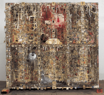 Retina (New Tong of Tangier I), 1992-93. Fly, plastic fly, oil, oil varnish, oil stick, wood glue, persimmon tannin, plastic resin, felt-tip pen, spray paint, putty, photograph, printed matter, cardboard, thin paper, paper, plastic sheet, cotton cloth, cotton thread, hemp cloth, wire, iron, plastic pipe, brass rivet, brass grommet, Japanese paper book, nail, leather, bulb socket, electric wire, wooden box, iron board, balsa, can, wood, wooden block, wooden shelf. 216 x 212 x 82 cm. Courtesy of the artist and Take Ninagawa, Tokyo.
