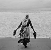 The lady with jellyfish, Kovalam, Kerala. Photo: Jason Scott Tilley