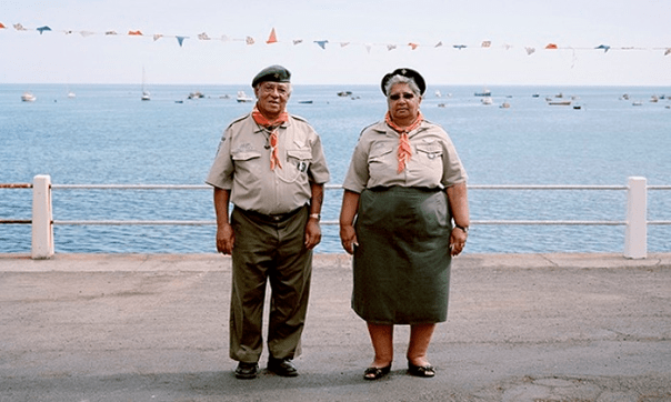 "Guardian: ""A couple on St Helena: 'Residents pose in their uniforms as if to emphasise their sense of belonging to Queen and country.' Photograph: Jon Tonks/Dewi Lewis"""