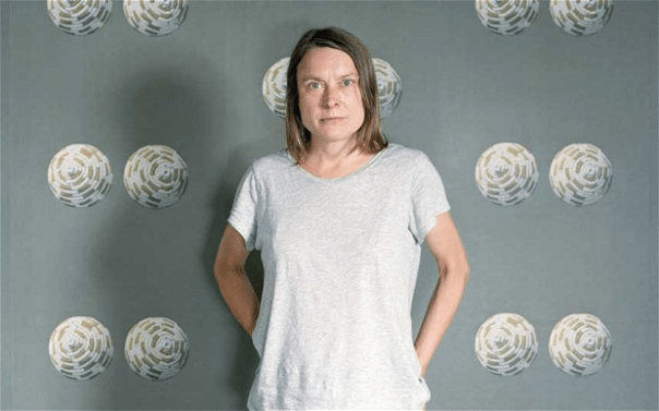 Sarah Lucas with her wallpaper Tits in Space, 2000, at the Whitechapel Gallery, 2013. Photo: Tina Hillier