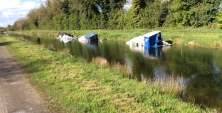Capsized boats on approach to 45th Lock