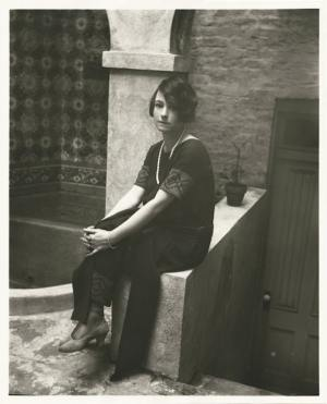 Public Domain Review: Dorothy Parker in 1924, photographed in the backyard of her New York residence.