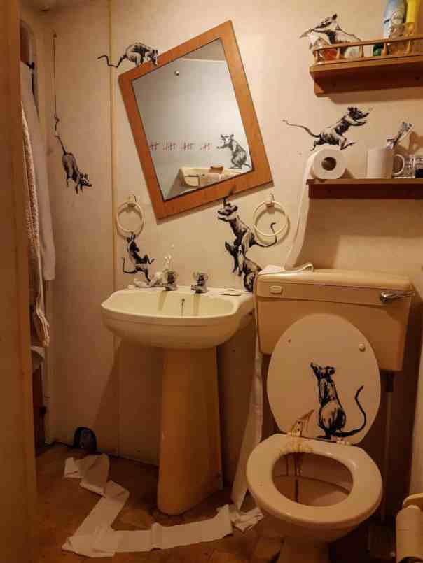 His images show rats - which have featured in many of his previous artworks - knocking the bathroom mirror to one side, hanging on the light pull, swinging on a towel ring and stepping on a tube of toothpaste Photograph: Banksy/PA