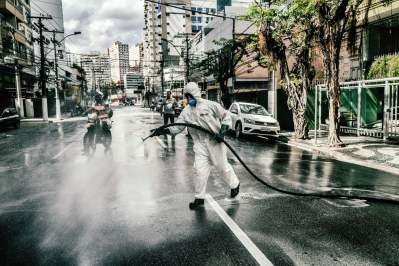 Street cleaners at work in Niteroi. Photograph: Nicoló Lanfranchi/The Guardian