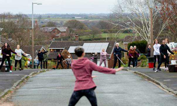Janet Woodcock leads her neighbours in Frodsham during a socially distanced dance they are doing every day in lockdown. Photograph: Peter Powell/EPA