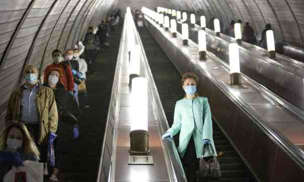 People wear face masks and gloves on the Moscow Metro. Russia now finds itself with the second fastest rate of Covid-19 infections in the world. Photograph: Alexander Zemlianichenko/AP