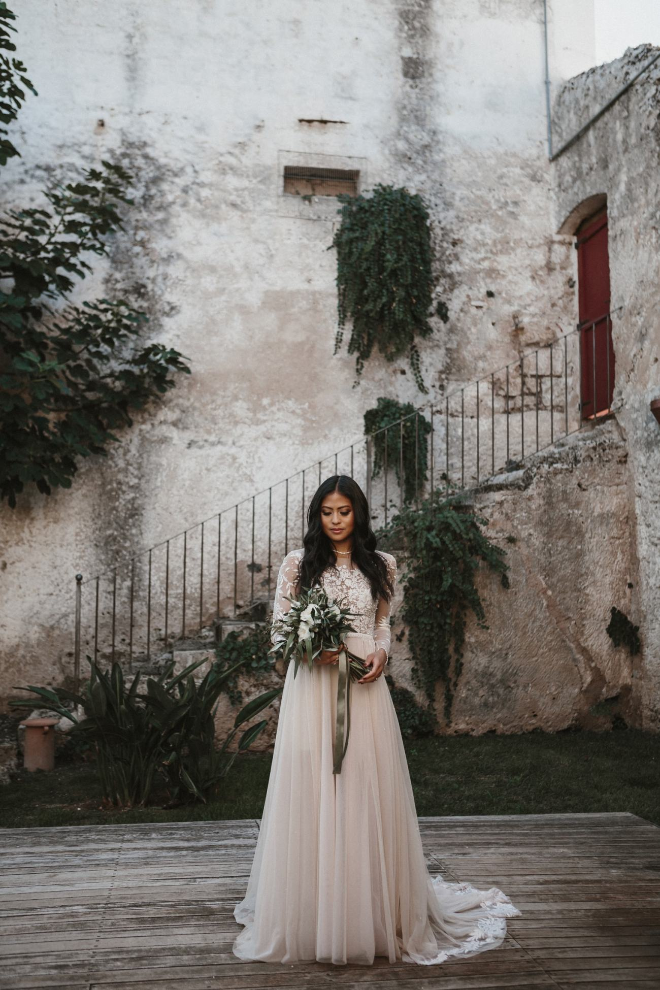 Apulian bride wearing beautiful Hermione de paula gown in italy for destination wedding