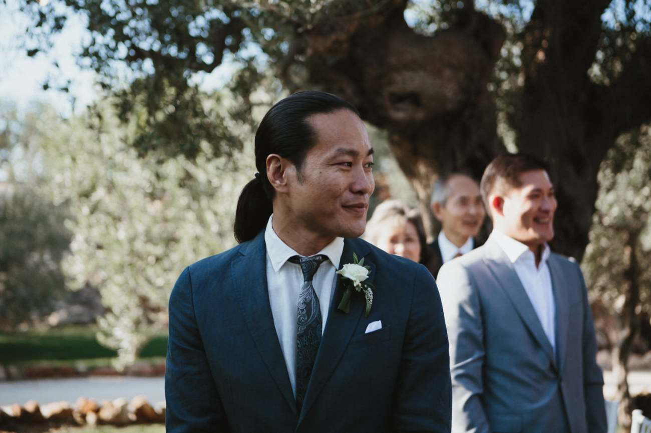 First look from groom at bride in Italy at ceremony