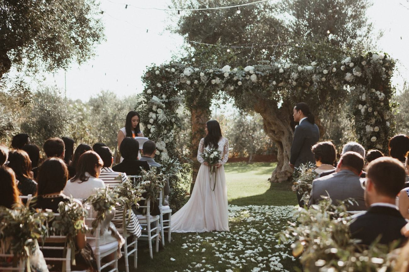 Beautiful floral arch at wedding ceremony in Puglia at masseria torre coccaro