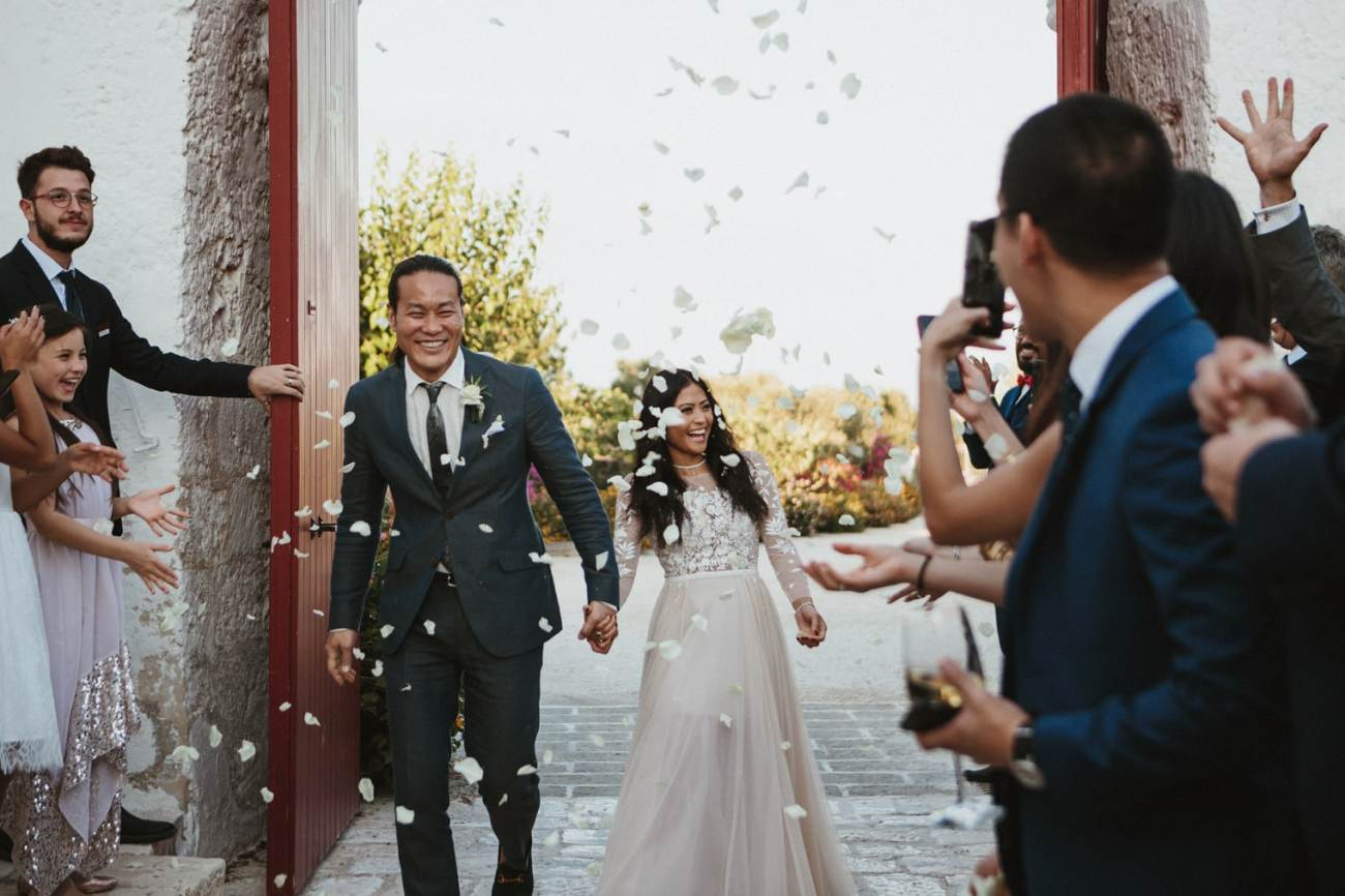 Italy wedding photographer captures bride and groom recession with confetti in Italy