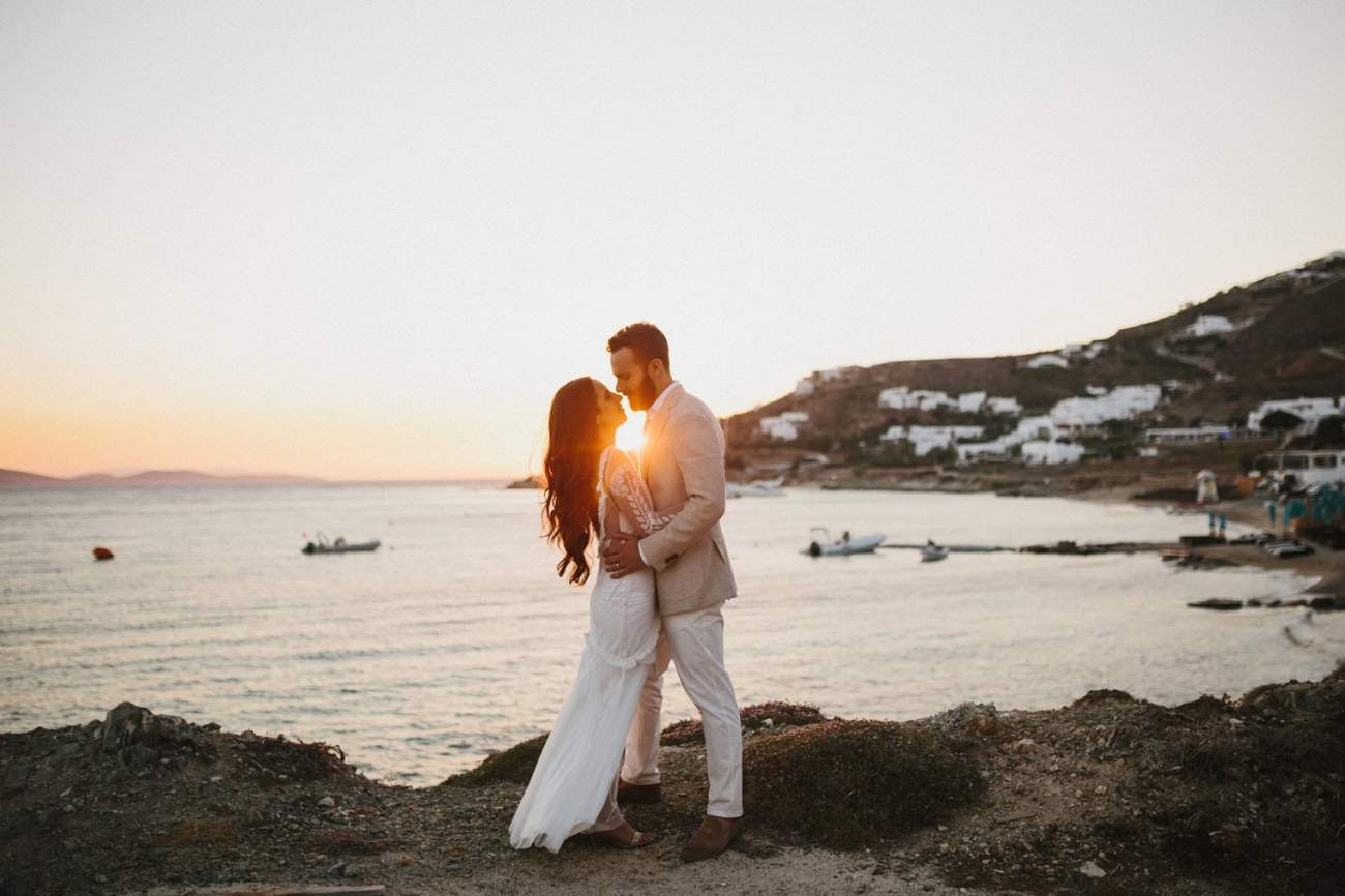 Bride and groom at sunset during their Wedding in Mykonos, Greece