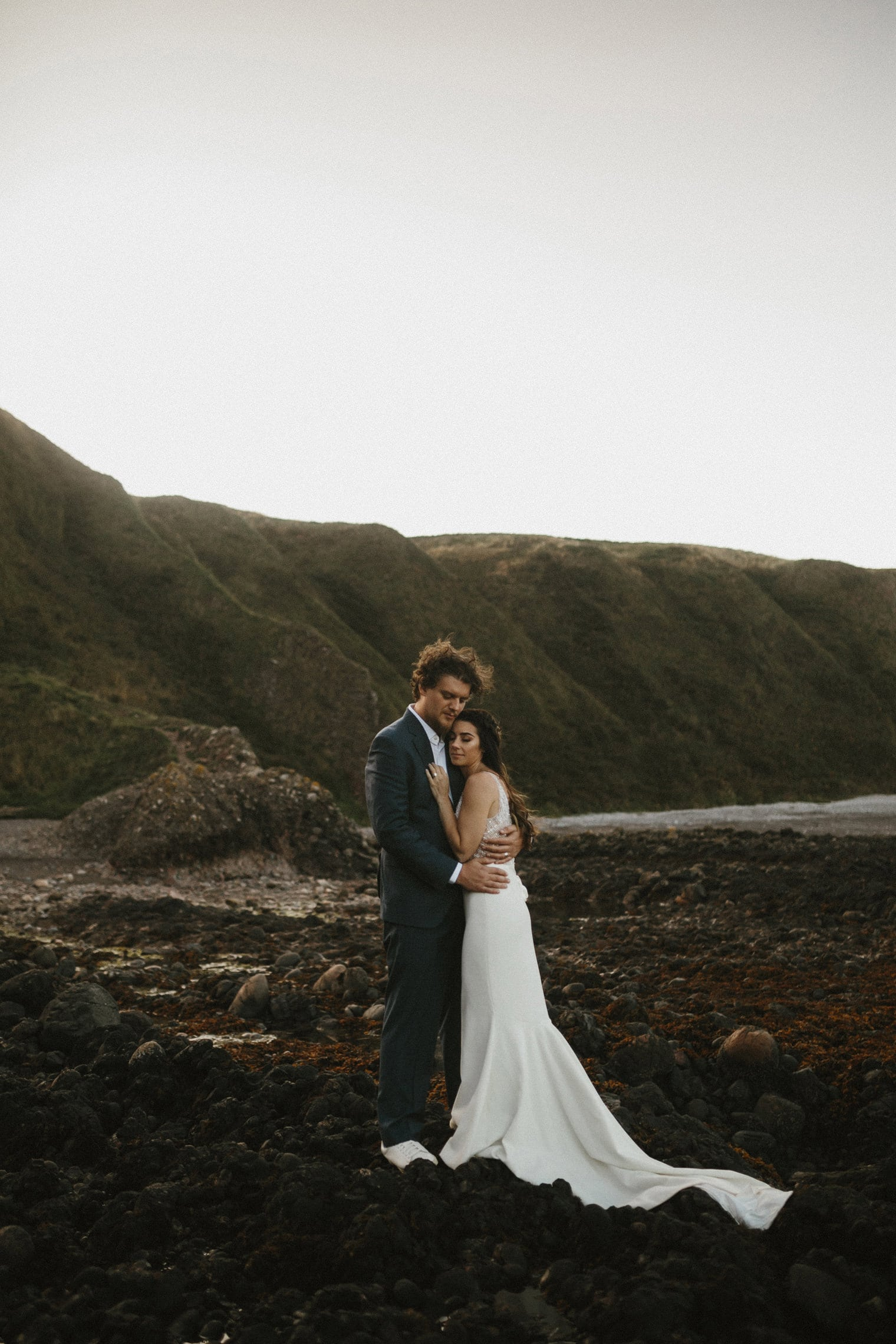 Bride and groom eloping at Dunnottar Castle